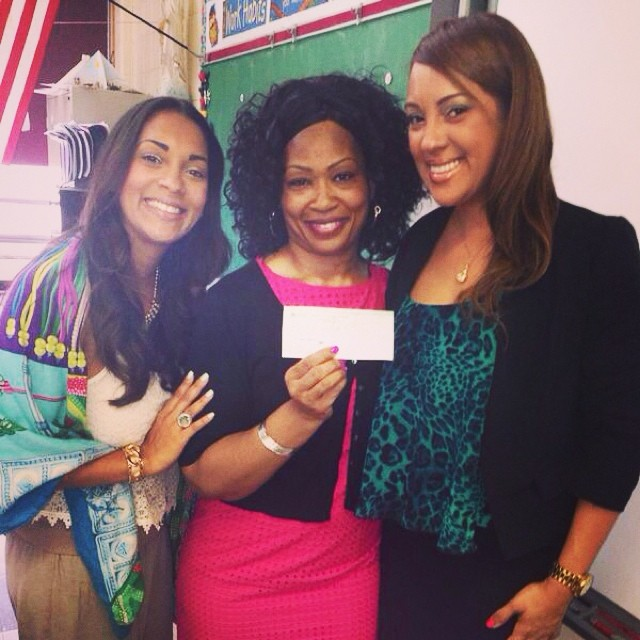 WIFFA Founders Diana & Nancy present Principal Tara Braswell with a check